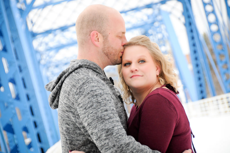 wedding engagment photos on a blue bridge