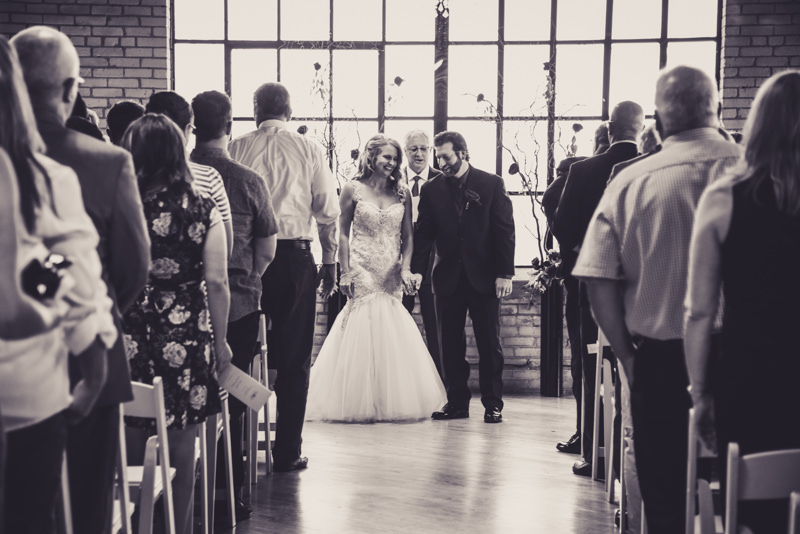 bride and groom walking down the aisle as man and wife