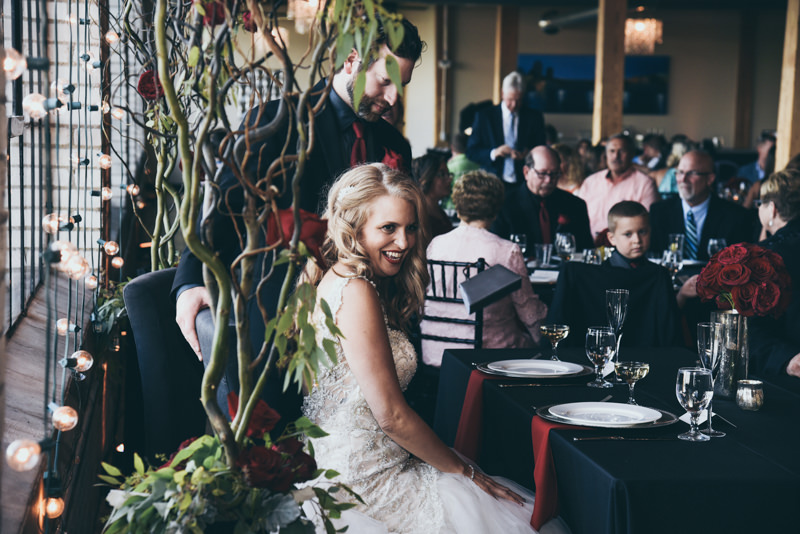 bride smiling at head table