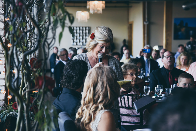 mother giving speech at a wedding reception