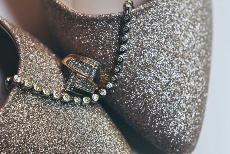 detail shot of shoes and jewelry