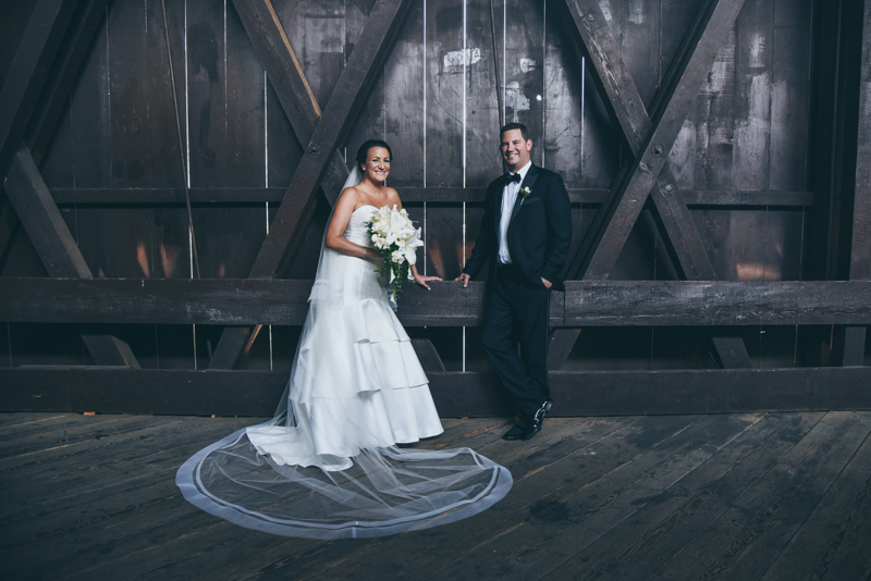 romantic image of a bride and groom in a covered bridge