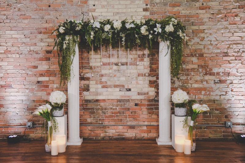 floral decorated arch at a wedding