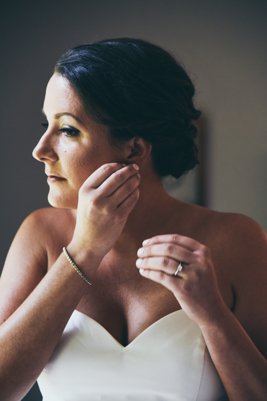 bride putting in her earrings
