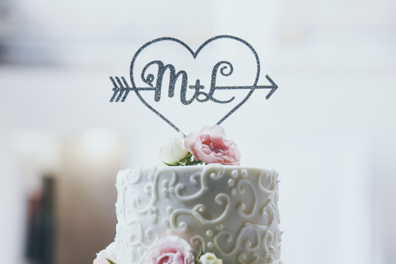 wedding cake with filigree and floral details
