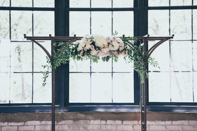 floral arbor at a wedding ceremony