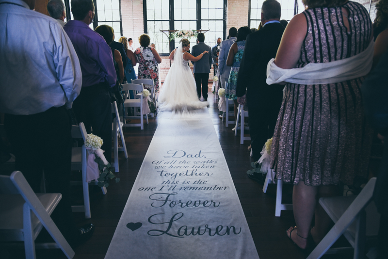 customized aisle runner at a wedding ceremony
