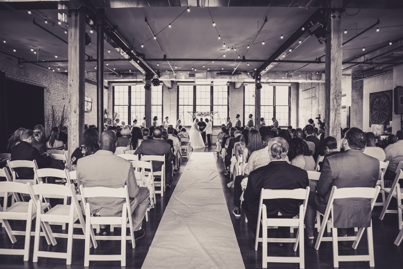 wide shot of a wedding at a loft venue