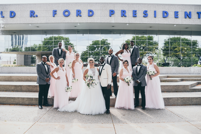 bridal party photos in front of the Gerald R Ford Presidential Museum