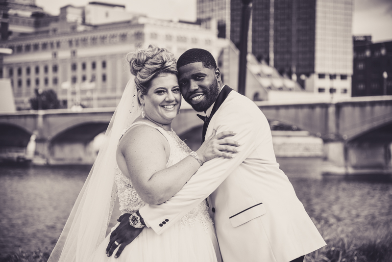 black and white image of a bride and groom in a cityscape