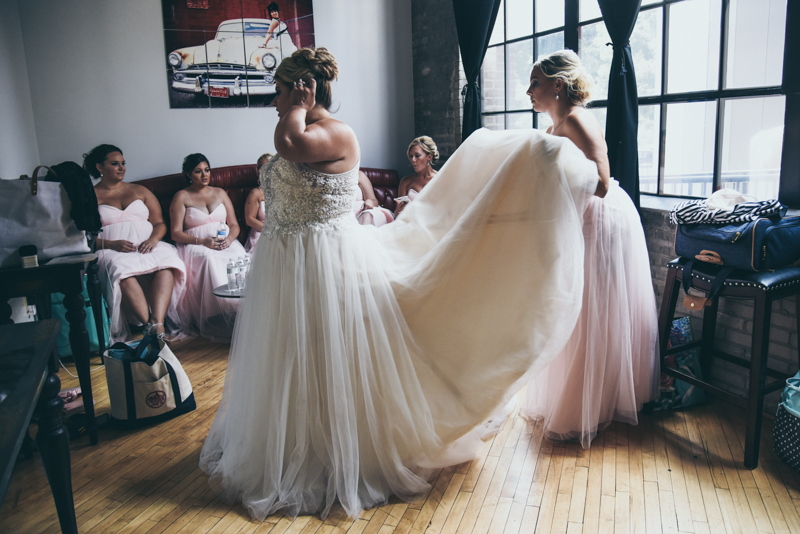 bride getting ready for wedding ceremony with bridesmaids
