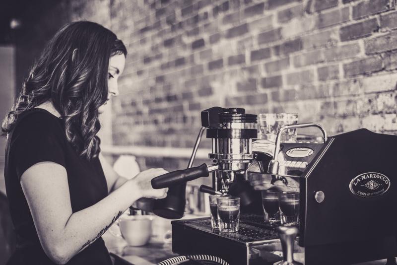 barista making espresso drinks