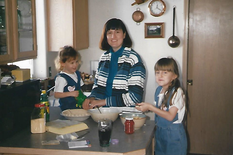 a mom baking with her kids