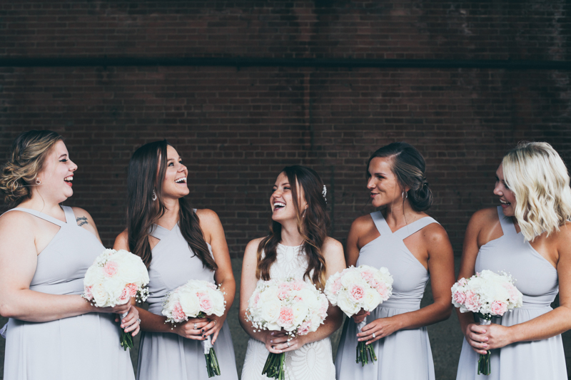 bridal party photos in a rustic loading dock area