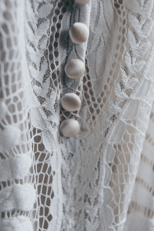 detail shot of a lace wedding gown